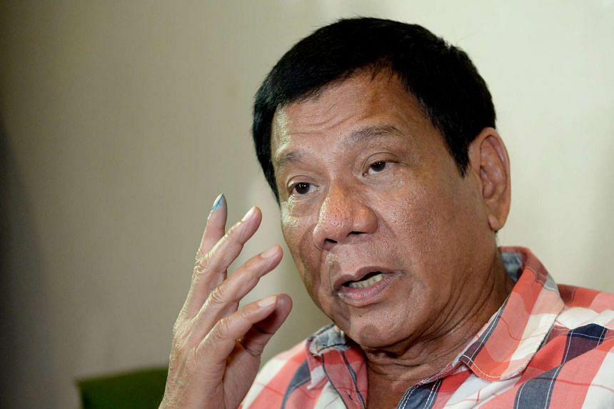 Mr Rodrigo Duterte gestures as he is interviewed by reporters at a hotel in Davao City, on May 9, 2016.