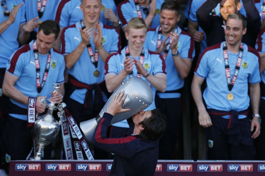 Burnley's Joey Barton celebrates with an inflatable trophy after winning the Sky Bet Football League.