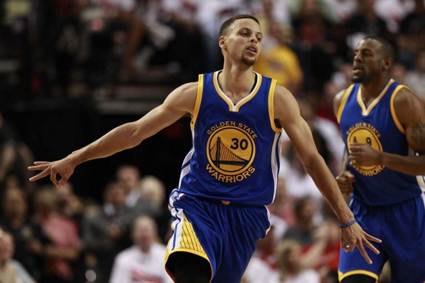 Golden State Warriors guard Stephen Curry celebrates making a three point shot in the second half of Game 4 of the NBA Western Conference semi-finals, on May 9, 2016.