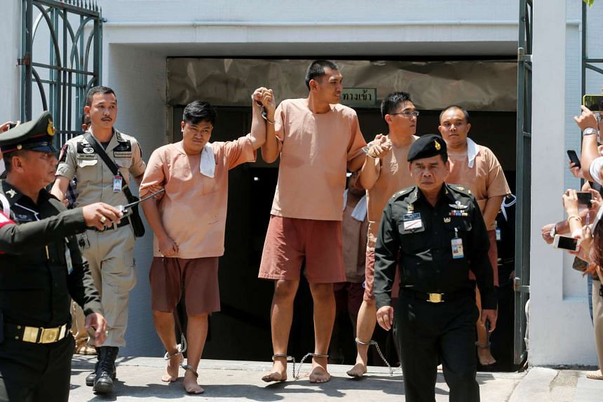 Activists who were detained after posting critical comments on Facebook of the ruling military junta, leave the military court in Bangkok, Thailand, on May 10, 2016.