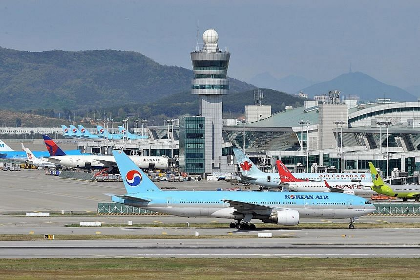 Flight SQ16, carrying 186 passengers and 18 crew, was departing from South Korea's Incheon airport (left) last Thursday when a Korean Air jet taxied near an intersection on the runway without permission. SIA pilots aborted the take-off in time to avo