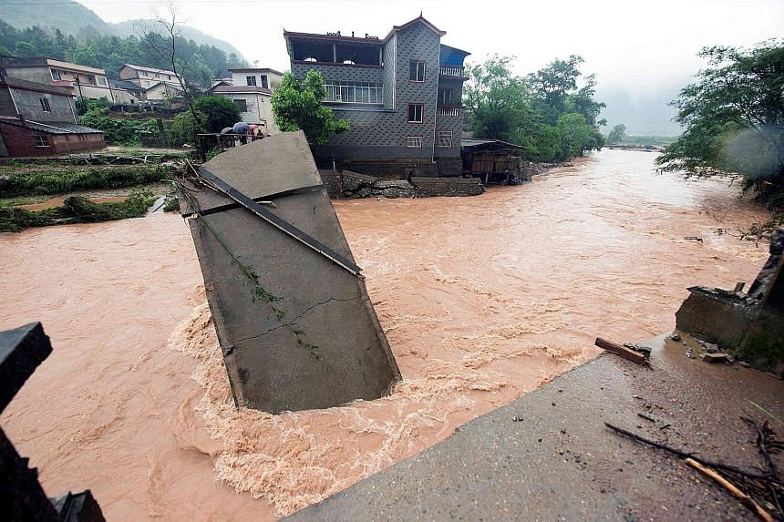 Torrential rain and flood waters caused this bridge to collapse in Guilin city in China's Guangxi Zhuang Autonomous Region yesterday. Heavy rain lashed much of southern and eastern China over the weekend, with Guangxi Zhuang among the hardest-hit are