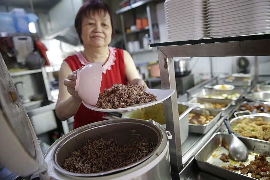 Madam Ding serving up brown rice at Fo Lai Ping (Popular) Vegetarian stall. She says five in 20 customers opt for brown rice over white.