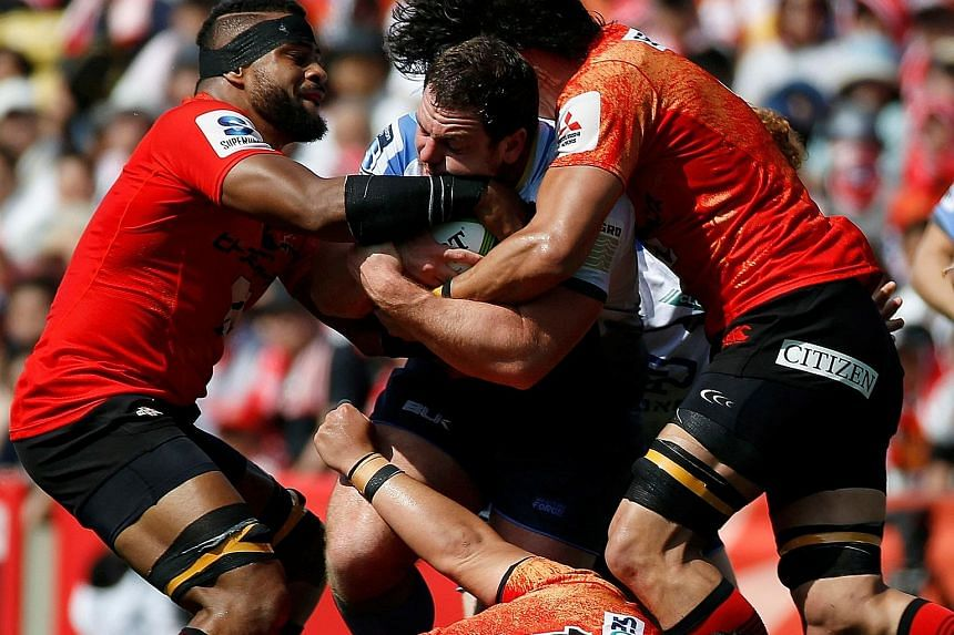 Sunwolves players surrounding Western Force's Guy Millar in their 40-22 loss on Saturday. Coach Mark Hammett insists that his side have improved throughout their maiden Super Rugby season.