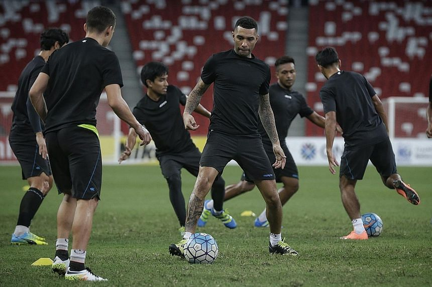 Jermaine Pennant (centre) training ahead of Tampines' AFC Cup clash against Selangor at the National Stadium tonight. The English winger has scored three goals for the Stags this season.