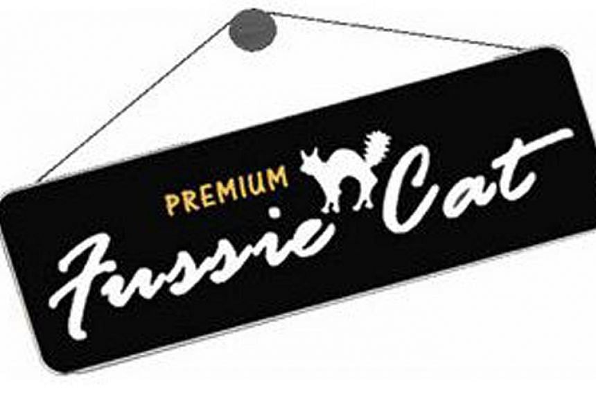 Trademark registrar Sandy Widjaja dismissed Pets Global's claims because its Fussie Cat mark (top), and B2K Pet Products' Kit Cat mark are more dissimilar than similar.