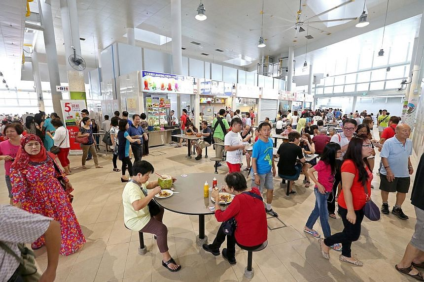 Diners at the Bedok Interchange hawker centre. Senior Minister of State for the Environment and Water Resources Amy Khor yesterday said that the Government will encourage hawkers, as much as possible, not to use disposable ware, particularly for dini