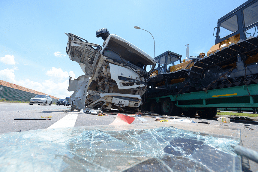 The accident involved a construction truck and a trailer carrying two bulldozers.