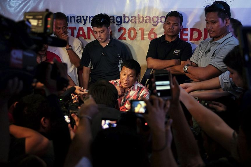 Mr Rodrigo Duterte, mayor of Davao City, speaking to the media after casting his vote during the presidential election in Davao, Mindanao, the Philippines.