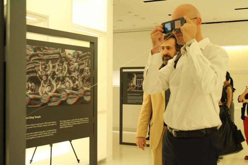 A guest using anaglyph 3D glasses to view a stereographic image at the exhibition.