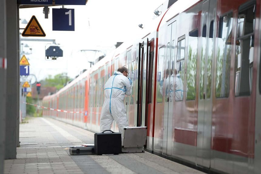 A forensic investigator of the German police next to a local train at the railway station in Grafing, near Munich, on May  10, 2016.