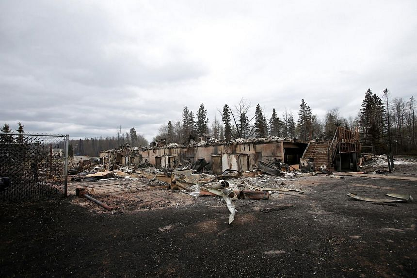 Burned out homes are pictured in the Abasand neighbourhood of Fort McMurray, Alberta, Canada, on May 9, 2016, after wildfires forced the evacuation of the town.