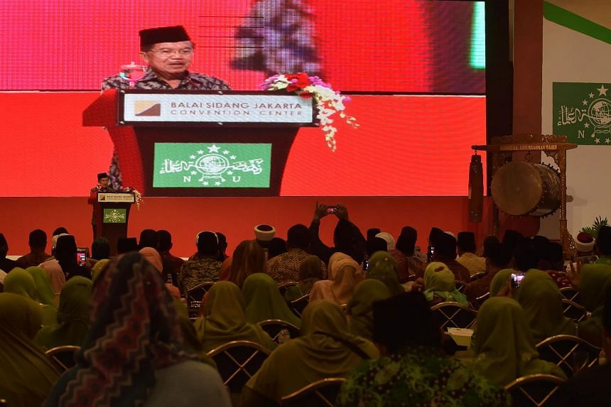 Indonesia's Vice President Jusuf Kalla delivers a speech during the opening ceremony of the International Summit of Moderate Islamic Leaders in Jakarta on May 9, 2016.
