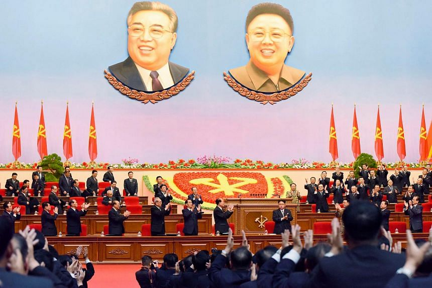 Participants applauding North Korean leader Kim Jong Un during the country's first ruling party congress.