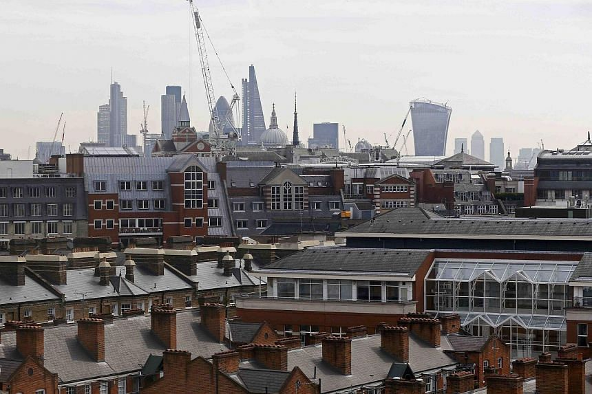 The skyline of the City of London and the Canary Wharf financial district on May 6, 2016.
