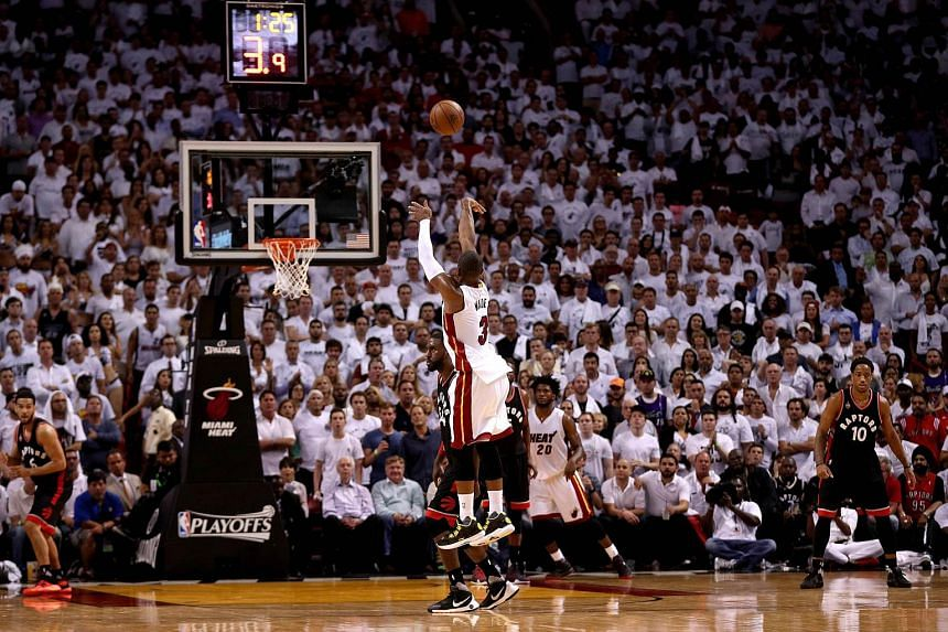 Dwyane Wade #3 of the Miami Heat shooting in overtime during Game 4 of the Eastern Conference Semifinals of the 2016 NBA Playoffs against the Miami Heat, on May 9, 2016.