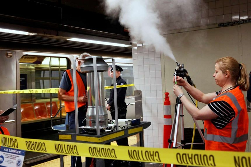 Department of Homeland Security and New York Metropolitan Transportation Authority members release chemical tracer devices in the New York subway system on Monday (May 9).