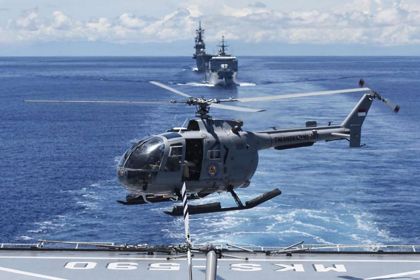 An Indonesian Navy helicopter takes off from a ship during the Komodo Exercise 2016.