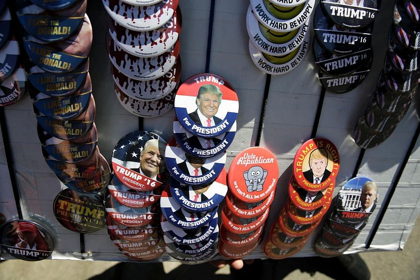 A vendor sells Trump buttons at a campaign stop for US Republican presidential candidate Donald Trump in Lynden, Washington, on May 7, 2016.