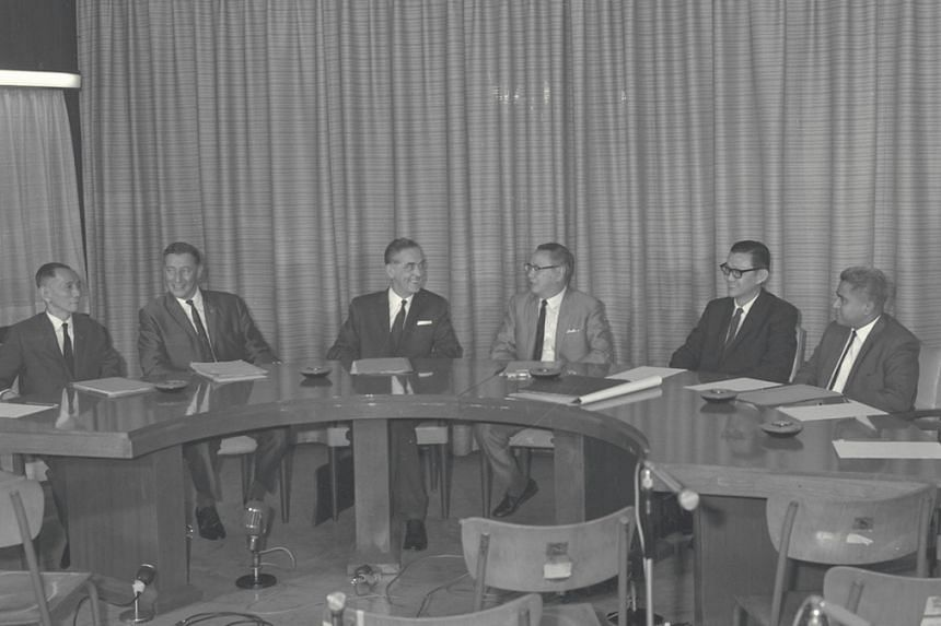 Finance Minister Mr Lim Kim San (fourth from left) at the first meeting of the new Board of Commissioners of Currency. Mr Lim said on June 12, 1967 that Singapore would issue its own currency.