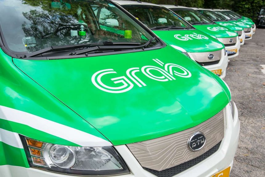 The Grab logo on cars.