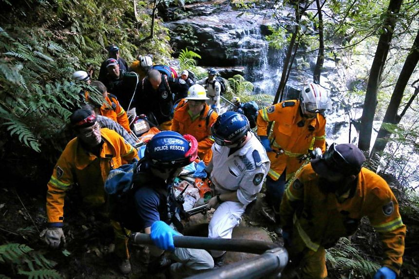 Emergency services carrying Ms Cheng Shi Min out of Empress Falls in the Blue Mountains on May 11, 2016 after she fell 20 meters down a waterfall.