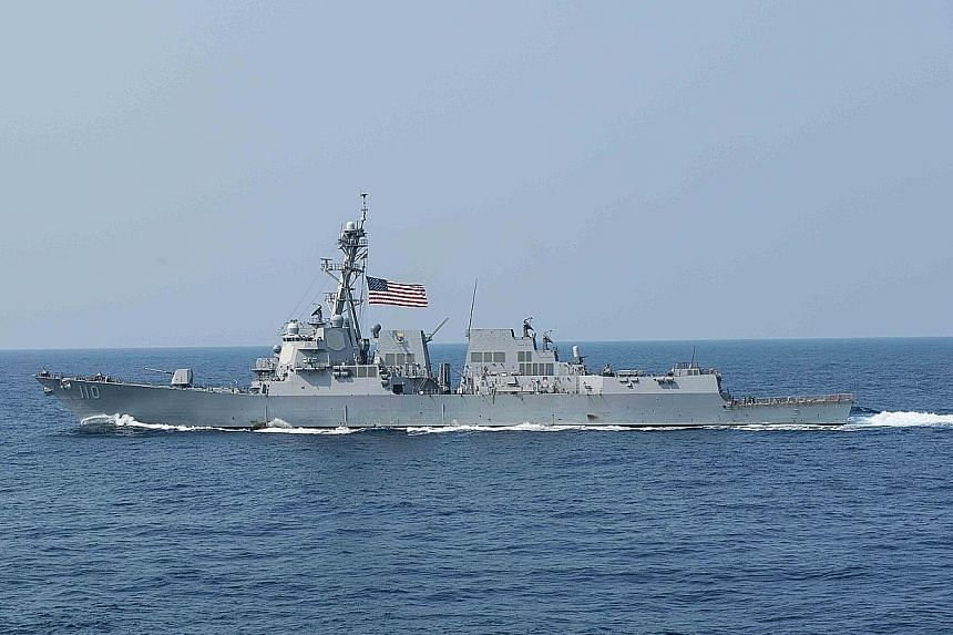 Guided missile destroyer USS William P. Lawrence (above) sailed within 22km of Chinese-occupied Fiery Cross Reef.