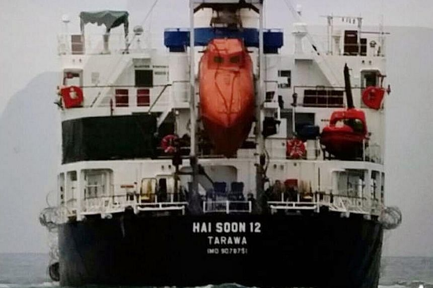 The MV Hai Soon 12 disappeared from radar in the Karimata Strait, said the Indonesian navy. The nine perpetrators (some seen above) climbed up the poop deck of the ship from a small boat in waters off Pulau Belitung.