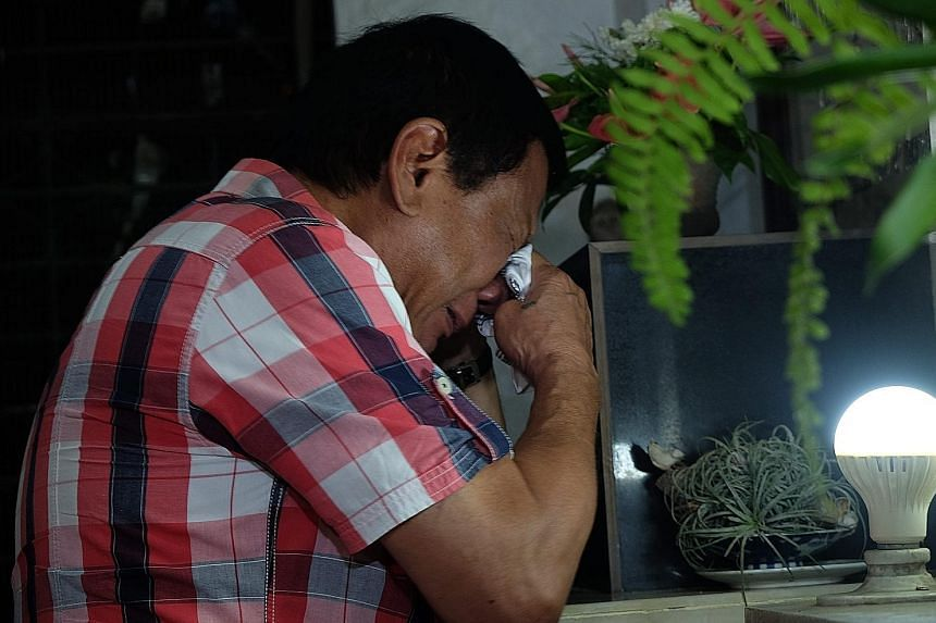 An emotional Mr Duterte visiting his parents' tomb at San Pedro Memorial Park in the Philippine city of Davao yesterday morning, after he secured the presidency. It is not clear when his victory will be officially declared, but the former Davao mayor