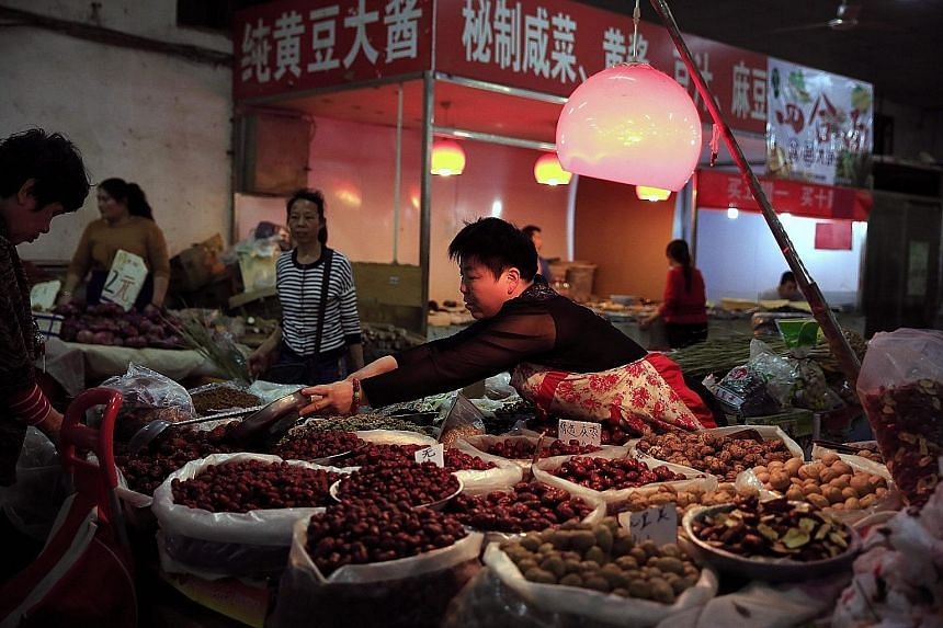 A market in Beijing. China's consumer price index rose 2.3 per cent in April from a year earlier, largely due to a spike in food prices, particularly pork.