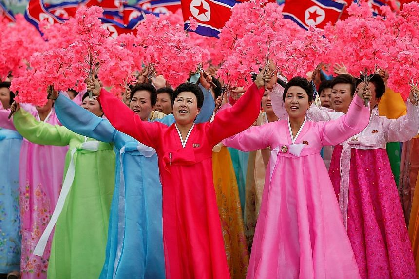 North Koreans at a mass rally and parade in Pyongyang's main ceremonial square yesterday, a day after the ruling party wrapped up its first congress in 36 years by elevating North Korean leader Kim Jong Un to party chairman.