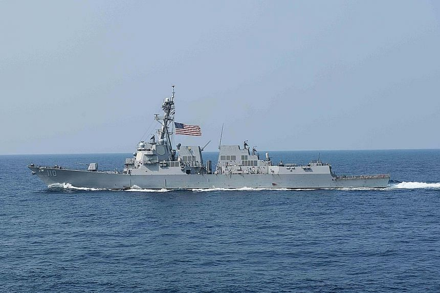 The guided missile destroyer USS William P. Lawrence sailed within 22km of Chinese- occupied Fiery Cross Reef.