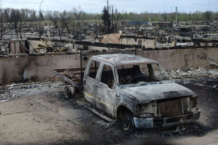 A burned out truck is seen during a media tour of the fire-damaged city of Fort McMurray on May 9, 2016.