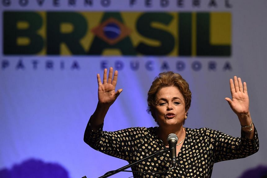 Brazilian President Dilma Rousseff gestures during the opening ceremony of the 4th National Policy Conference on Women in Brasilia on May 10, 2016.