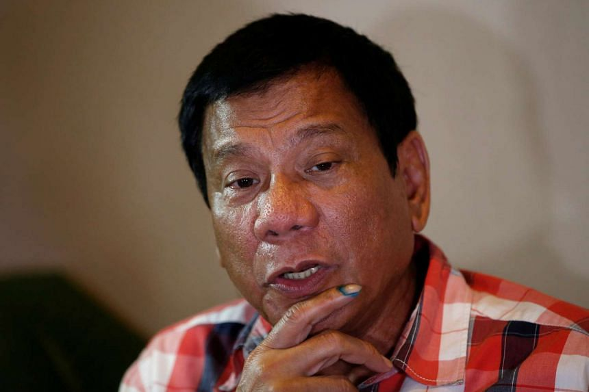 Duterte talks to reporters in Davao city in the southern Philippines, May 9, 2016.