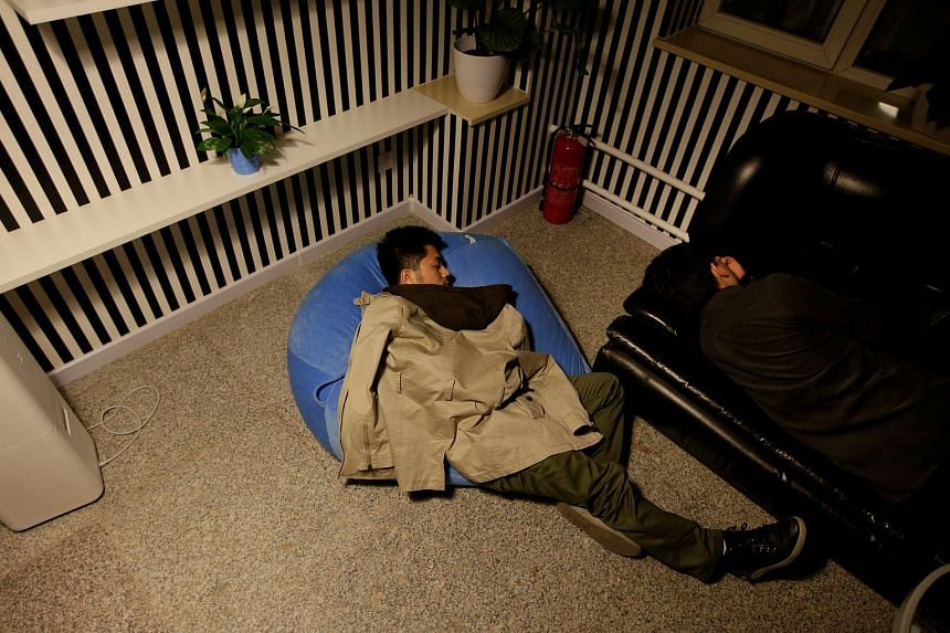 Workers at start-up data company Goopal Group taking a nap during a break at work at around midnight in Beijing.