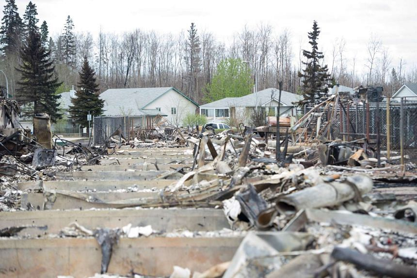 Fort McMurray is still 90 per cent intact despite a week of damage from the wildfires.