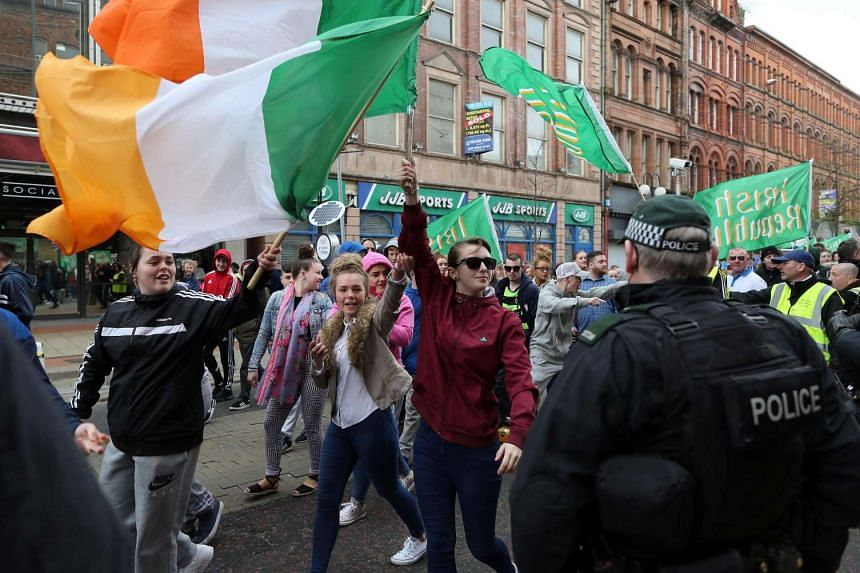 Republicans march through Belfast city centre in Northern Ireland on April 24, 2016, in commemoration of the 1916 Easter Rising.