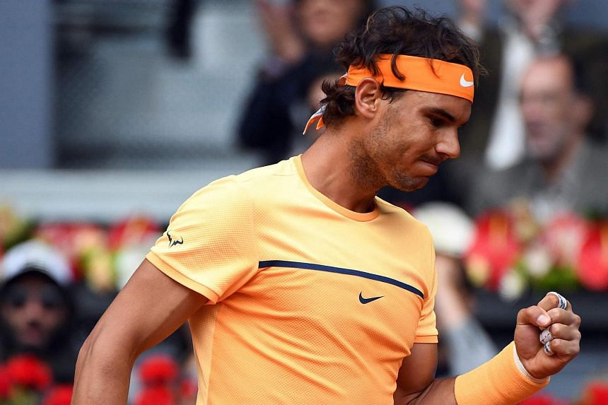 Spanish tennis player Rafael Nadal gesturing as he plays against Britain's tennis player Andy Murray on May 7, 2016.