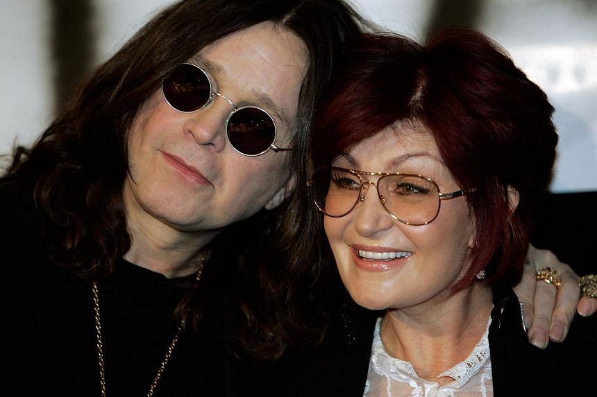This file photograph taken on Feb 6, 2007 shows  Ozzy Osbourne (left) and his wife Sharon posing for reporters during a press conference in Los Angeles.