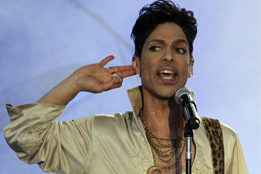 Prince performs at the Hop Farm Festival in southern England.