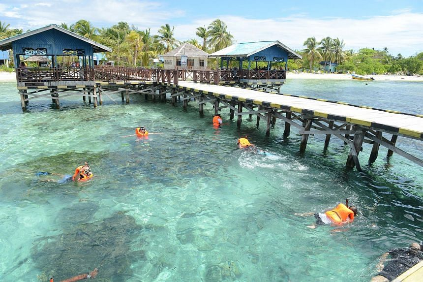 Visitors snorkelling at Arborek, one of the many islands popular among tourists in Indonesia's Raja Ampat.