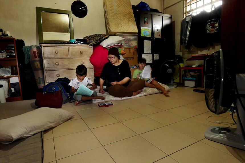 Ms Renemarlina and her two children went from living in a three-room flat to staying in her parents' rental flat after she got divorced. She is currently looking for a job and intends to buy a Housing Board flat once she can afford one.