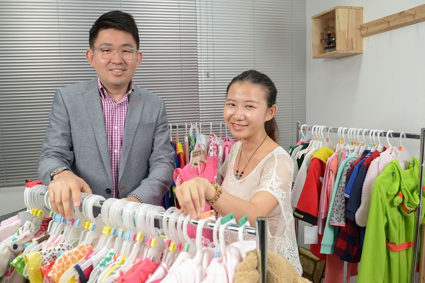 Mr Teo with his designer, Ms Evy Yu, at Teo Garments' head office in Shaw Road. With the help of IE Singapore, Mr Teo's company embarked on a joint venture with New York-based importer Mad Dog Concepts to gain immediate access to the US apparel m