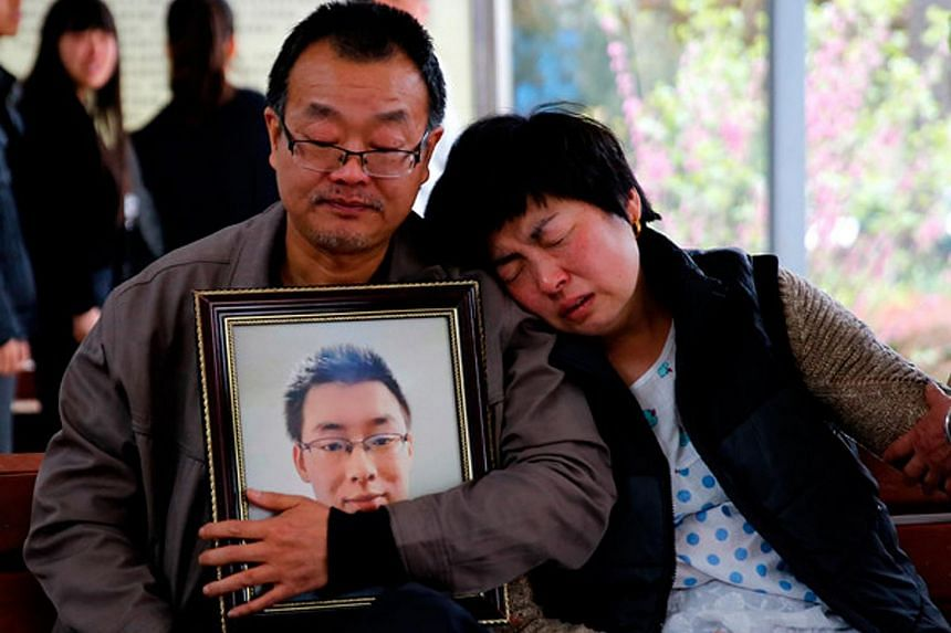 The parents of Wei Zexi, a computer science major at Xidian University in Shaanxi province who died of a rare form of cancer, waiting outside a funeral home in Xianyang, Shaanxi, on April 13, 2016.
