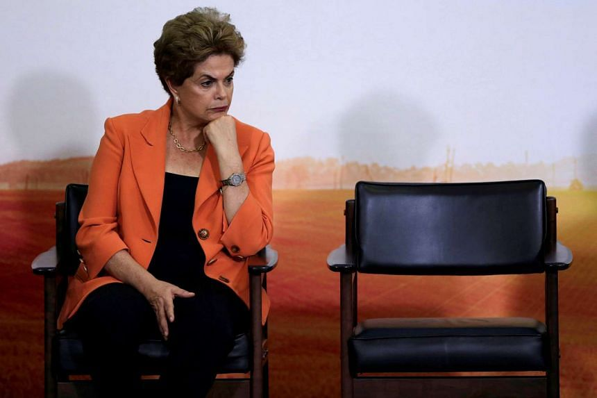 Brazil's President Dilma Rousseff has vowed to keep fighting impeachment charges against her, after the Senate voted to put her on trial for breaking budgetary rules.