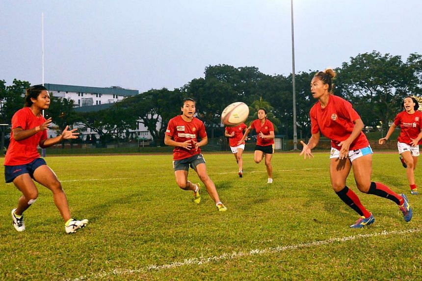 Members of the Singapore women's rugby team, undergoing training at the Yio Chu Kang Stadium on March 17, 2015.