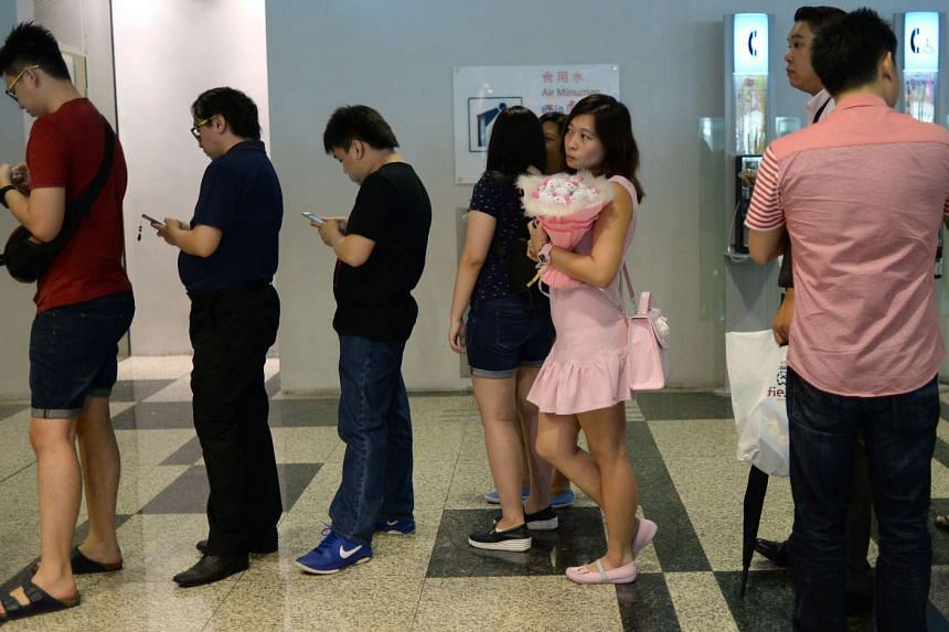 Hundreds flocked to Changi Airport Terminal 3 for the opening of Hello Kitty Orchid Garden Cafe. Fans like property consultant Jeanette Lee, 37, even came dressed for the occasion.