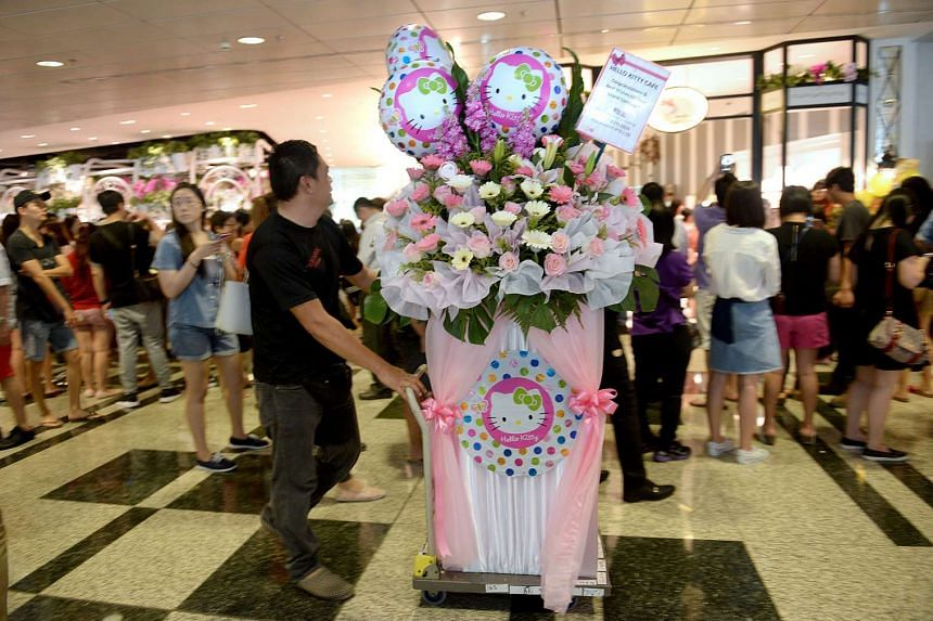 Hundreds flocked to Changi Airport Terminal 3 for the opening of Hello Kitty Orchid Garden Cafe.