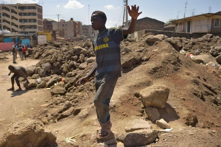 A homeless boy walking in a landfill in the Kenyan capital of Nairobi.